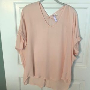 Peach colored loose fitting blouse